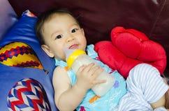 Protrait of baby boy with milk bottle Stock Photo