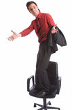 Proud. Businessman stands on chair Stock Image