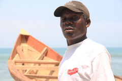 Proud African fisherman with his boat, Ghana Stock Photo