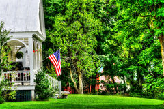 Proud American HDR. American flag on the front porch of an old home in rural America HDR Stock Image