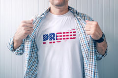 Proud American patriot wearing white shirt with USA flag print Royalty Free Stock Photo