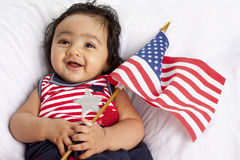 Proud Asian American Baby Celebrating July Fourth. Proud Asian American Baby Girl Celebrating July Fourth - American Independence day royalty free stock photos
