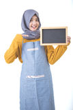 Proud asian cafe owner holding blank sign blackboard Stock Images
