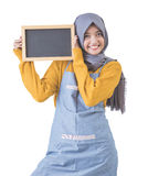 Proud asian cafe owner holding blank sign blackboard Stock Photography