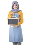 Proud asian cafe owner holding blank sign blackboard Royalty Free Stock Image