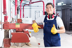 Proud Asian carpenter showing thumbs up Stock Photos