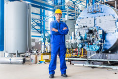 Proud Asian worker in production factory Stock Image