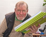 Proud author of new book. Senior holding copies of a new children's book just published and in great demand Stock Images