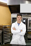 Proud baker standing in his kitchen Royalty Free Stock Photography