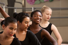 Proud Ballet Student. With peers in a dance studio royalty free stock photo