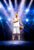 Proud basketball player is praying befor mach Stock Image