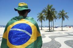 Proud Brazilian Wearing Flag Copacabana Rio de Janeiro stock photos
