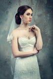 Proud bride in her wedding dress Stock Images