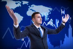 Broker rising hands as celebration gesture. Proud broker man rising hands up as celebration of success gesture on background with increasing graph and world map stock photography