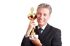 Proud business man with trophy Royalty Free Stock Photo