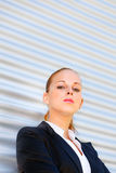 Proud business woman standing at office building Royalty Free Stock Image