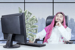 Proud businessman looking money on monitor Stock Photos