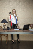 Proud businesswoman with a big hammer Royalty Free Stock Photos
