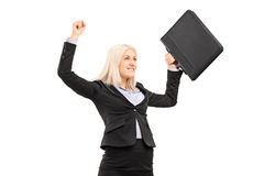 Proud businesswoman gesturing success isolated on white backgrou Stock Images