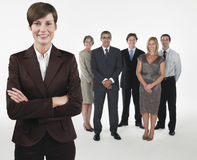 Proud Businesswoman With Team Behind Stock Photography