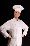 Proud Chef. Assertive portrait of a smiling proud female Chef in uniform Royalty Free Stock Photos