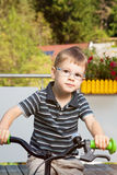 Proud child on bike Royalty Free Stock Image