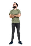 Proud confident bearded man with crossed arms looking up. Full body length portrait isolated over white studio background stock images