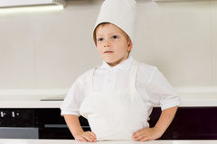 Proud confident boy in a chefs uniform Stock Photo