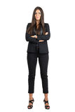 Proud confident corporate woman in formal wear with crossed arms looking at camera Stock Photography