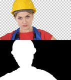 Proud confident young woman worker with arms on hips, Alpha Channel royalty free stock image