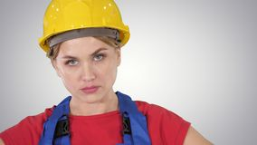 Proud confident young woman worker with arms on hips on gradient background. stock footage