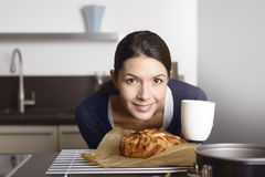 Proud cook bending to a freshly baked apple cake Royalty Free Stock Image