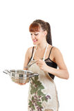 Proud cook with pot in the kitchen wearing apron Stock Photo