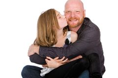 Proud Dad getting a cheek kiss from his daughter stock photos