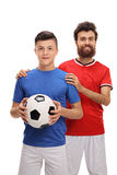 Proud father with his son dressed in sport jerseys Royalty Free Stock Images