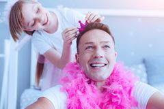 Proud father playing with adorable daughter stock images