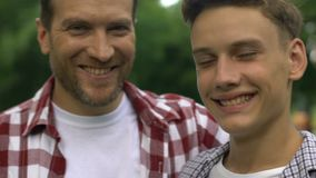 Proud father praising successful teenage son, trust-based relations in family. Stock footage stock video