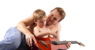 Proud father teaching his son Royalty Free Stock Image