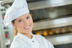 Proud female baker in kitchen Stock Images