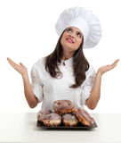 Proud female chef with doughnuts Stock Images