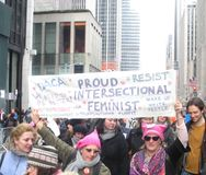 Proud Feminists, Intersectional Feminism, Women`s March, Midtown, Manhattan, NYC, NY, USA. Demonstrators marching down 6th Avenue during the Women`s March on New Royalty Free Stock Photo