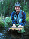 Proud fisherman. A nice large brown trout caught in the strawberry river utah as displayed by proud fisherman Stock Photography