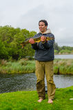 Proud fisherman with a pike Stock Images