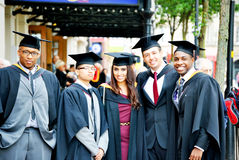 Proud friends and graduates Stock Photos