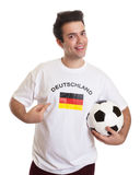 Proud german soccer fan with football Royalty Free Stock Image