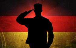 Proud german soldier on german flag background Royalty Free Stock Photos