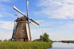 Proud Giant Dutch Windmill. Standing Giant Windmill waiting for the strong wind royalty free stock photography