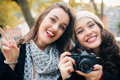 Proud girl friends with an old analog SLR camera Royalty Free Stock Photo