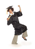 Proud grad marching. Happy young graduating woman marching proudly during graduation ceremony stock photo