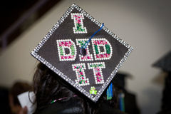 Proud Graduate. A Female student at a graduation ceremony with the I did it on her cap listening to the commencement speaker at the University of Central Florida Stock Images